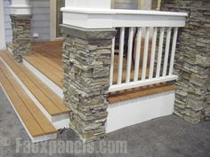Illustrates finishes: Stained decking on porch, steps and ramp, painted white foundation and rails, stacked stone base for columns