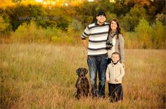 Fall family photo in the grass