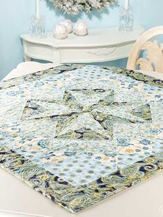 """A large center star with pieced squares surrounding it makes for a quick-to-stitch project. This e-pattern was originally published in Quilted Christmas Traditions. Size: 36"""" x 36"""". Block Size: 18"""" x 18"""" finished.Skill Level: Intermediate"""