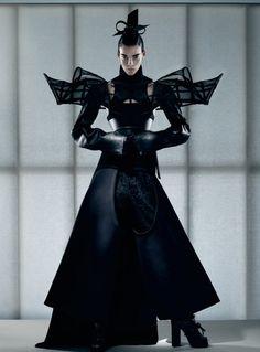 Sculptural Fashion - dress with dramatic 3D shoulder detail and voluminous silhouette - avant garde fashion; dark fashion