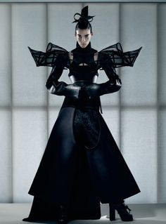 Sculptural Fashion - dress with dramatic 3D shoulder detail and voluminous silhouette - avant garde fashion; dark fashion