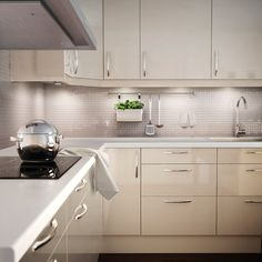 FAKTUM kitchen with ABSTRAKT yellow-white high-gloss doors/drawers and KANSLI chrome-plated handles