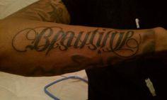 Beautiful/Diaster.  Sick ambigram tattoo.