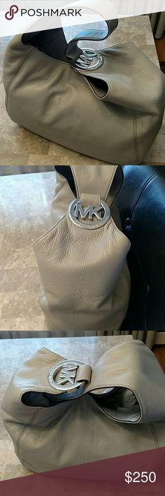 "Michael Kors Fulton Handbag  Pearl Gray approximately 10""H by 13*W by 6"" D 9"" handle drop  1 zipper pocket and 4 pockets inside Michael Kors Bags Hobos"
