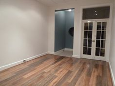Natural white walls, spotted gum floating floorboards.