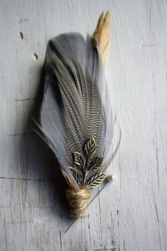feathers bound with jute/linen thread. Use pearl/crystal beads?