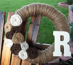 Personalized/ Monogram Jute Yarn Wreath with burlap flowers. $40.00, via Etsy.
