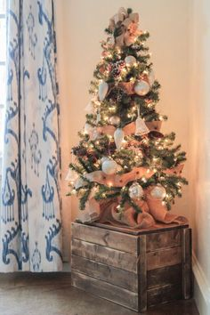For a shabby chic vibe, try wrapping strands of burlap around an already-twinkling tree. See more at Shanty 2 Chic »