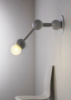 Wall lamp with swing arm Bras Collection by Forestier | design Laurence Brabant