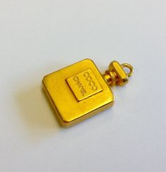Vintage Coco Chanel perfume miniature pendant, gold plated, excellent condition by JijiVintage on Etsy https://www.etsy.com/listing/247011245/vintage-coco-chanel-perfume-miniature