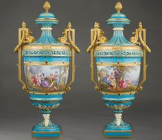 A Pair of Sevres Lidded Vases