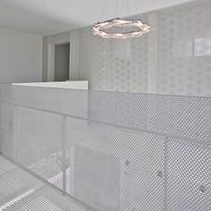 """Japanese architects StudioGreenBlue have completed """"Distance of Fog"""", a house in Kōnosu City, Saitama Prefecuture, Japan,with an interior featuring white perforated screens throughout the space."""