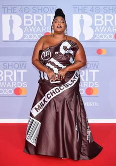 Keeping up with her quirky fashion sense, songstress Lizzo posed on the red carpet of the 2020 BRIT Awards in a Hershey's chocolate bar . Jorja Smith, Mollie King, Billie Eilish, Jean Paul Gaultier, Women's Dresses, Fendi, Burberry, Fashion Show, Fashion Outfits