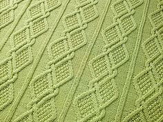 Ravelry: Moss Diamonds Cabled Baby Blanket pattern by nalhcib