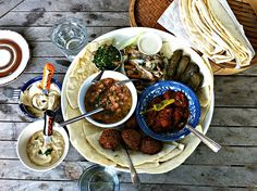 LOOKS YUMMY, tray of falafel, homous, baba ghanouj, grape leaves, and pita from Aladdin's Cafe in Portland, OR