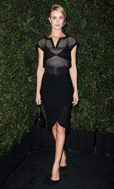 Rosie Huntington-Whiteley in a black sheer top and tulip pencil skirt.