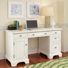A fantastic desk for your home office and ready to stand double duty as a hallway occasional table, this white pedestal desk features a drop-down keyboard tray and plenty of storage space including five roomy drawers and a CPU compartment.