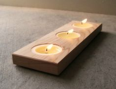 """Warm tones of wood and candles add lovely light to any space. Made from reclaimed cedar wood in a choice of colors. - First picture is """"light""""We recycle old woo"""