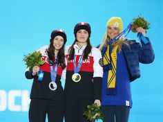 Sochi 2014 Day 15 - Medals Ceremony Gold medallist Marielle Thompson of Canada and silver medalist Kelsey Serwa of Canada celebrate during the medal ceremony for the Women's Ski Cross on day 15 of the Sochi 2014 Winter Olympics at Medals Plaza