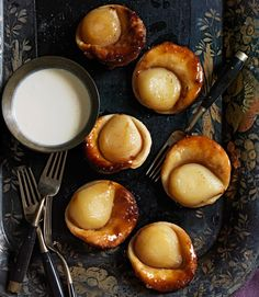 Each tiny pastry shell cradles half a Bartless pear bathed in a buttery glaze. To gild the lily, drizzle brown-sugar crème fraîche over top. Recipe: Pear Tartlets with Brown Sugar Crème Fraîche   - CountryLiving.com