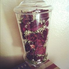 Great way to keep your favorite flowers- dry them out,  spritz em with hairspray, and place them in a clear apothecary jar- or any thing with a lid or top and voila! Love that now I can keep the flowers my husband sent during his deployment for as long as I want :)