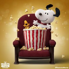 Woodstock and Snoopy in chair with popcorn. The Peanuts Movie.
