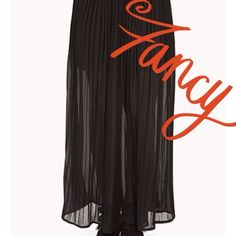 Sheer black pleated skirt Totally on trend Size medium Decree sheer maxi skirt pleated with elastic waist and mini skirt underlay . 3rd picture is just to see how it can look on actual skirt does not have a slit. Decree Skirts