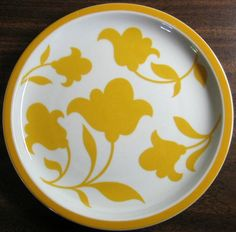 Decorative Dishes  (http://www.decorativedishes.net/mod-flower-power-golden-yellow-flowers-portugal-plate/)
