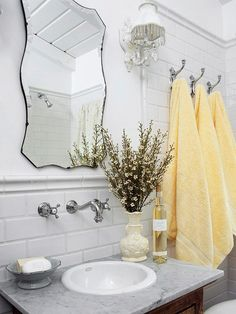 A rustic mirror and dried flowers add vintage flair to this small bath. More of our favorite small baths: http://www.bhg.com/bathroom/small/our-favorite-small-baths-that-live-large/?socsrc=bhgpin050513vintagebath=14