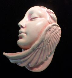 This face is now available on Etsy. Handmade ceramic half face winged angel maiden beading jewelry