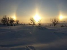 January 7, 2014 I got this picture off of our local tv station's website of a sun dog. Also known as  mock sun or phantom sun, scientific name parhelion, is an atmospheric phenomenon that creates bright spots of light in the sky, often on a luminous ring or halo on either side of the sun. Sundogs may appear as a colored patch of light to the left or right of the sun, 22° distant and at the same distance above the horizon as the sun, and in ice halos.