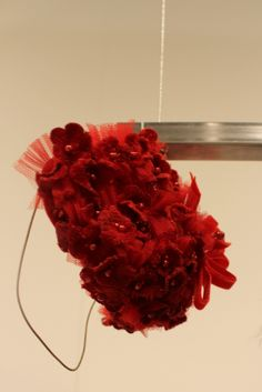 Beautiful flower red headbands from the Quis Quis fall winter 2014 collection at the 78th edition of the Pitti Bimbo in Florence. #QuisQuisKids #FW14 #fall #winter #fallwinter2014 #childrens #kids #childrenswear #kidswear #kidsfashion #girls #boys #pittibimbo78 #pittibimbo