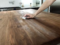 How We Refinished our Butcher block Countertop - Chris Loves Julia - Kitchen Countertops Butcher Block Island Top, Butcher Block Countertops Kitchen, Butcher Block Table Tops, Walnut Countertop, Walnut Butcher Block, Wooden Countertops, Countertop Materials, Butcher Blocks, Kitchen Cabinets