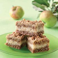 Apple bars with a sweet, creamy apple filling layered between a crunchy oat crust and topping.