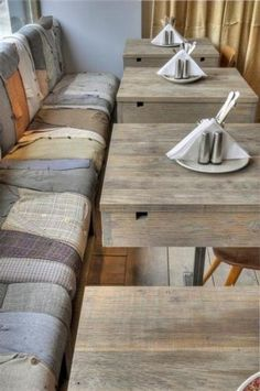 Restaurant bench upholstered with old clothing items - suits, jeans, etc...