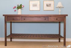 This beautiful Walnut console table can be found in our clearance event:  http://www.norfolkoak.com/clearance/#targetAnchor31