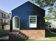 Architecture studio Vokes and Peters has created a new timber-panelled interior for a heritage property in Queensland, Australia, and built a new cottage-like extension at the rear Bungalow Interiors, Bungalow Renovation, Timber Architecture, Architecture Images, Modern Family House, Queenslander, Facade House, House Exteriors, Bungalows