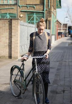 A girl, her dots and her bike