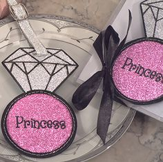 """Princess"" Pink Glitter Tag You will be treated like royalty when traveling with out Princess luggage tags. Travel in style with our shimmering diamond ring shaped luggage tag in silver and pink glitter accented with the word ""Princess"". http://www.favorfavor.com/page/FF/PROD/DC652"