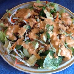 Sometimes vegans eat salads as big as their head for lunch with red pepper cashew dressing and nut meat