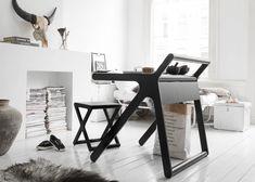 Rafa Kids' K-shaped desk hides a secret storage compartment
