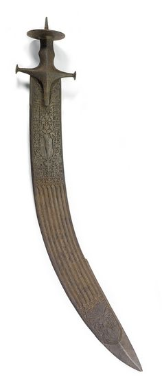 A MASSIVE RITUAL SWORD (TEGHA), PROBABLY MADHYA PRADESH, 18TH CENTURY the broad curved blade carved with a variety of animal, human and decorative motifs in a lattice-like pattern around a central panel featuring a stylised cypress tree, the reverse of blade with similar design, including the engraved image of a local deity or high priest near the tip on both sides, the wide hilt also composed of forged steel and engraved with medallions enclosing figures, traces of gilding throughout…