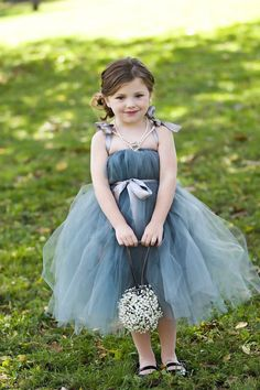 The perfect gray tulle flower girl dress for your wedding! A Tutu Dress made from Platinum Gray Tulle featuring Platinum Tied Sleeves and Sash. We can