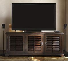 Media console for tv. Maybe Nate can reconstruct the shutter design on another one?