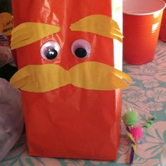 I bought super cute baggies, pompom noses and google eyes to make these treat bags!!