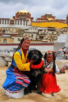 Tibetan mother, daughter and dog- I think it is a Tibetan terrier ;)