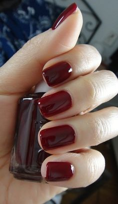 Deep red manicure nails
