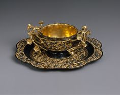 Tea Cup and Saucer  Period: Edo period (1615–1868) Date: dated 1731 Culture: Japan Medium: Shakudo (copper alloy) and gold