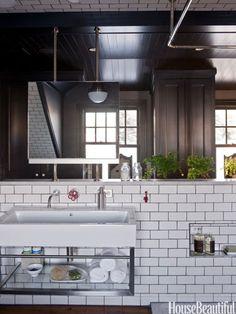 Ceiling-mounted medicine cabinet. Design: Dan Ruhland. housebeautiful.com. #bathrooms #cabinets