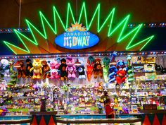 AS OLD AS I AM, I LOVE THE PRIZE TABLE AT THE CANADIAN MIDWAY!!! IT'S ALWAYS SO MUCH FUN TRYING TO DECIDE WHAT TO PICK. I REALLY WANT TO WIN ONE OF THOSE BIG PLUSHIES ONE DAY!!!:)  Prize table at the Great Canadian Midway on Clifton Hill in Niagara Falls